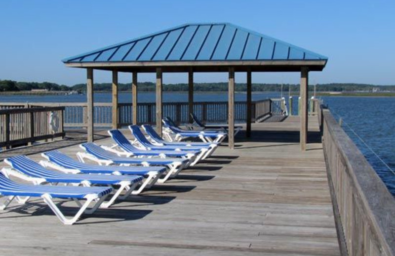 Dock With Lawn Chairs at Bluewater Resort