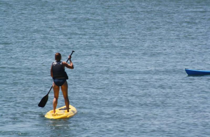 Paddle boarding at Island Club Rentals.