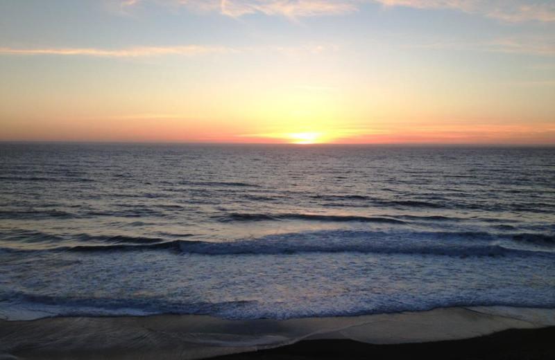 Sunset on the beach at Cavalier Beachfront Condominiums.