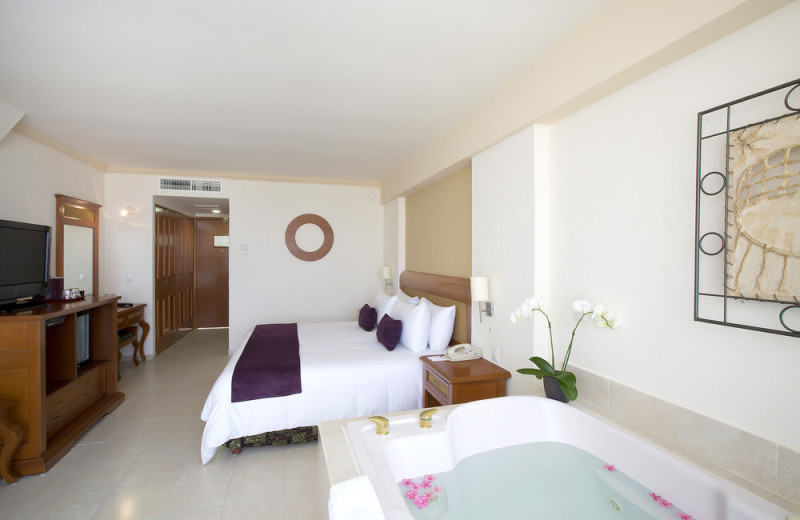 Guest room at Golden Parnassus Resort & Spa Cancun.