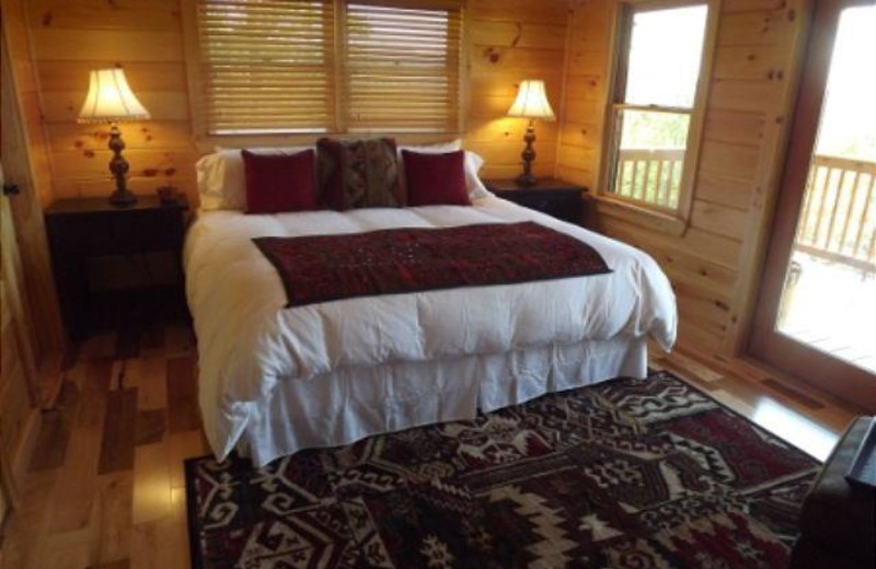 ONE OF 3 KING BEDS LOCATED IN OUR BEAUTIFUL VIEW MOUNTAIN CABIN EACH BEDROOM HAS IT'S OWN BATHROOM