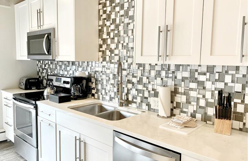 Guest kitchen at Aspen Square Condominium Hotel.