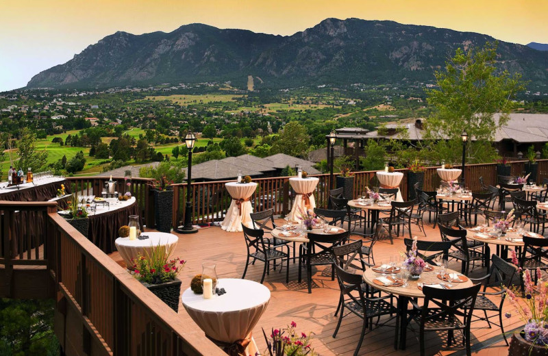 Outdoor dining on the Grand Rivers Terrace at Cheyenne Mountain Resort.