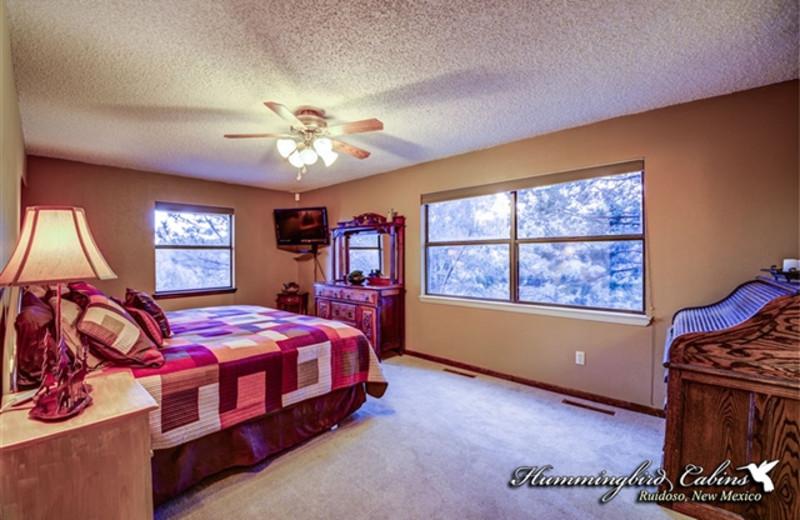 Bedroom at Hummingbird Cabins - Holly House Vacation Rental