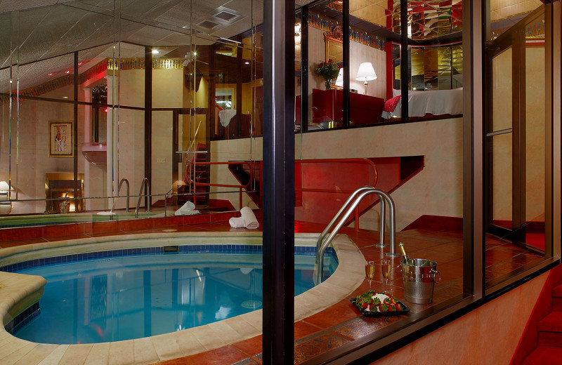 Indoor heated heart-shaped pool in the Champagne Tower Suite at Cove Haven, Pocono Palace and Paradise Stream Resort.
