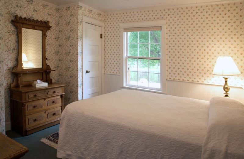 Cabin bedroom at  Sylvan Dale Guest Ranch.