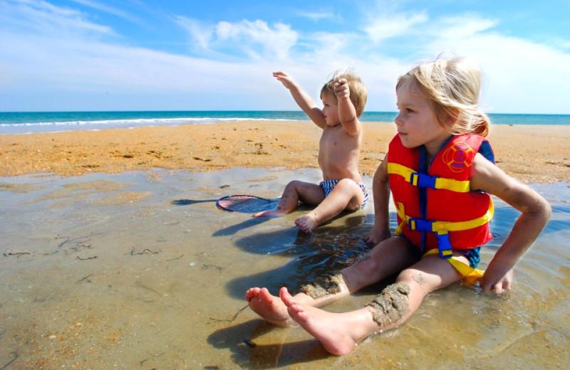 Kids Playing at Beach at Hatteras Realty