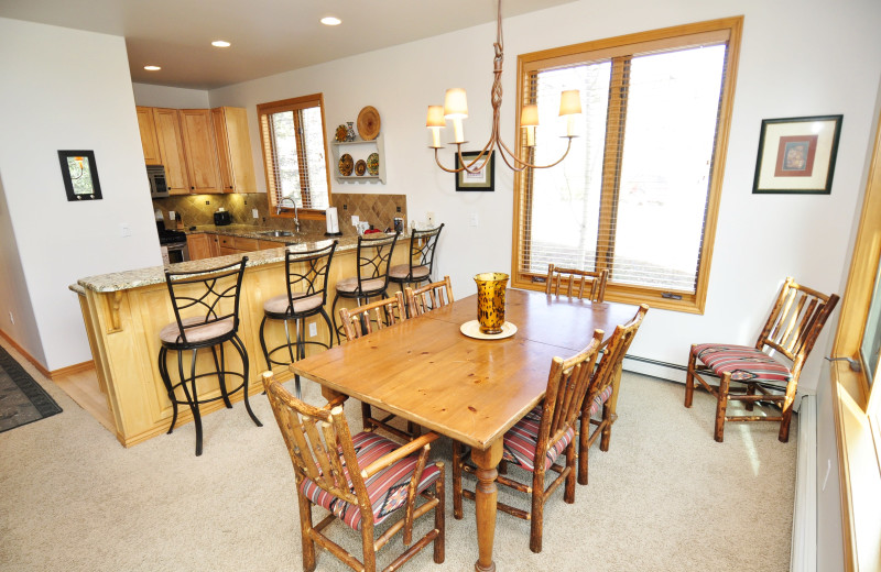 Rental kitchen and dining area at Steamboat Lodging Properties.