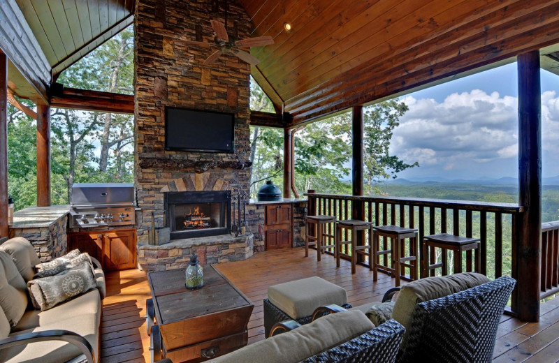 Cabin patio and grill at Mountain Top Downtown Lodging.