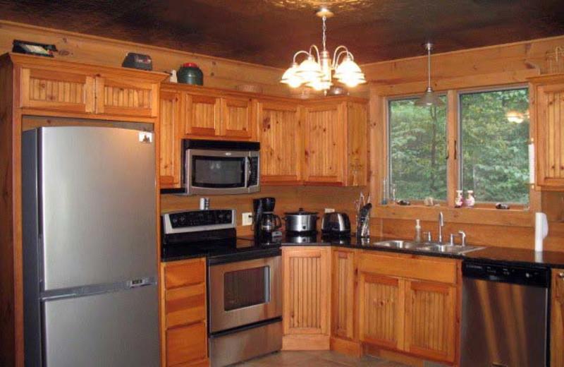 Cabin kitchen at Black Bear Cabin Rentals.