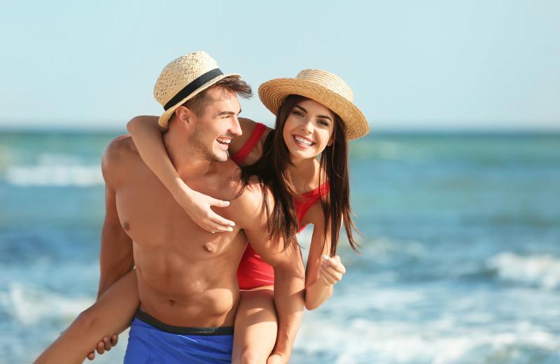 Couple on beach at Anna Maria Island Beach Rentals, Inc.