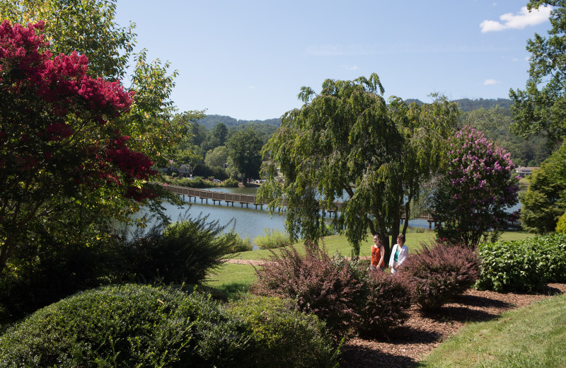Guests stroll by Lake Junaluska on a warm summer day.