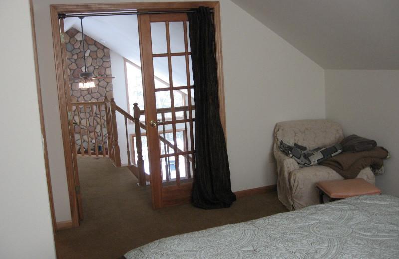 Cabin bedroom at Northwoods Vacation Rentals.