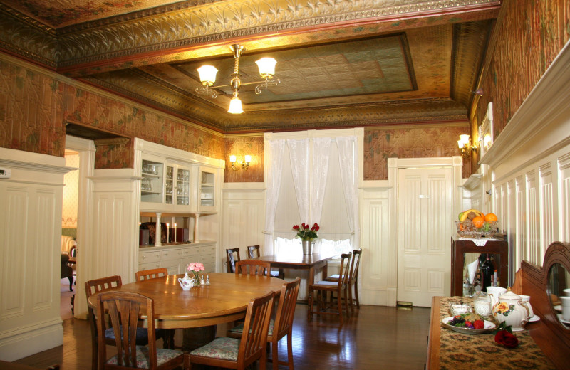 Dining Room with hand painted stamped tin ceiling Hennessey House Bed & Breakfast.