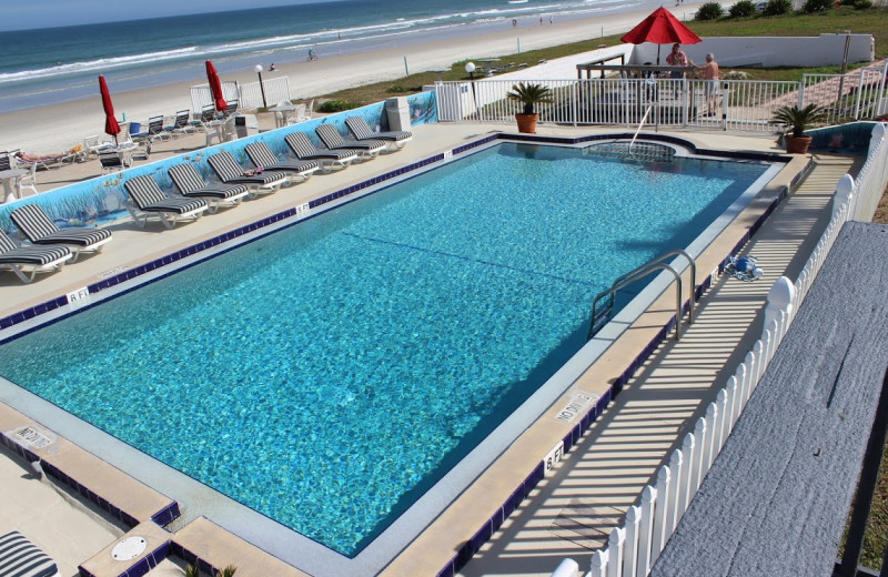 Outdoor pool and beach at Cabana Colony Cottages.