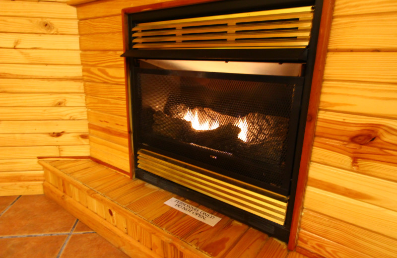 Relax by your cabin fireplace at Ozark Cabins.