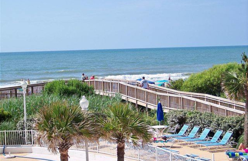 Vacation rental poolside and beach at Myrtle Beach Vacation Rentals.