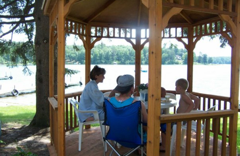 Family in the gazebo by the lake at Shady Hollow Resort.