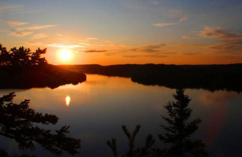 Sunset over lake at Golden Eagle Lodge.