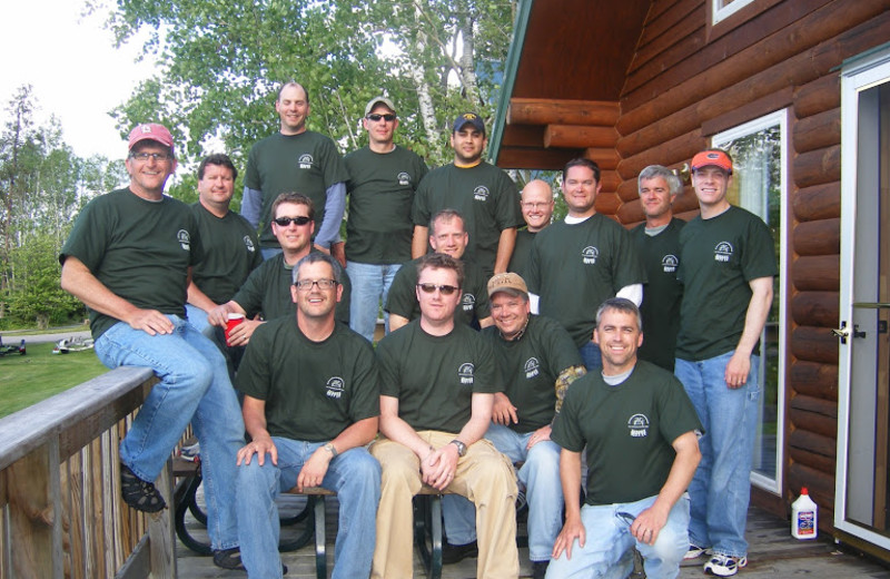 Fishing group pictured on the deck of the Sandpiper cabin.