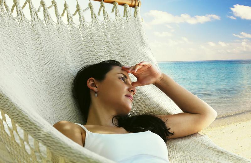 Relaxing on beach near Sanatra Inn.