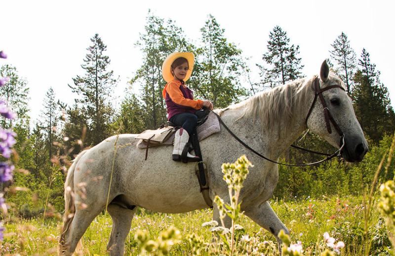 Horseback riding at Triangle X Ranch.