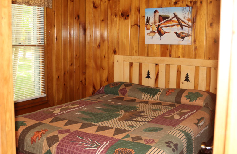 Cabin bedroom at Timber Trails Resort.