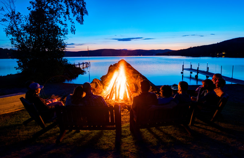 Enjoy awesome sunsets and endearing campfires along side international Lake Wallace at Jackson's Lodge, Canaan, Vermont's Northeast Kingdom.