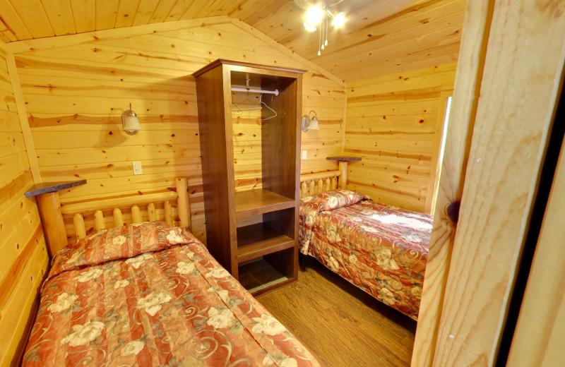 Cabin bedroom at Buffalo Point Resort.