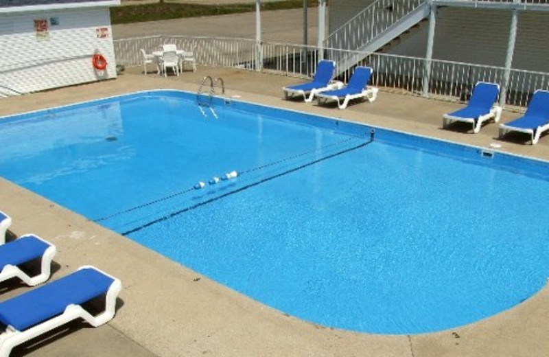 Outdoor pool at AmazInn & Suites.