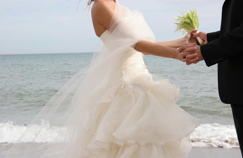 Wedding on the beach near The Chateau Inn & Suites.