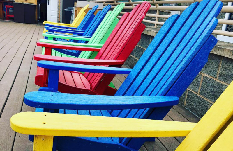 Adirondack chairs at Surfside on the Lake Hotel & Suites.