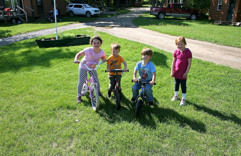 Kids on bikes at Timber Trails Resort.