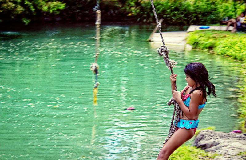 Swinging on rope at Geronimo Creek Retreat.