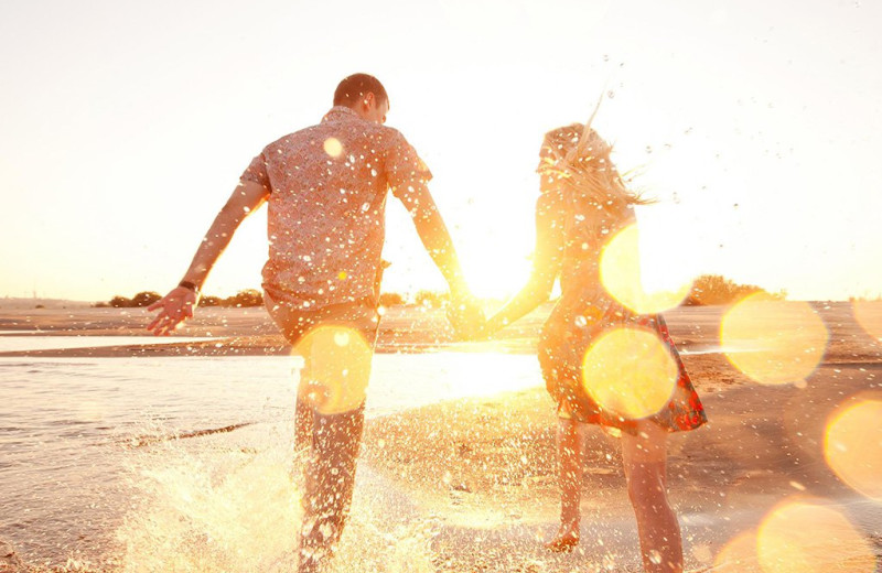 Couple on beach at Islander Hotel & Resort.