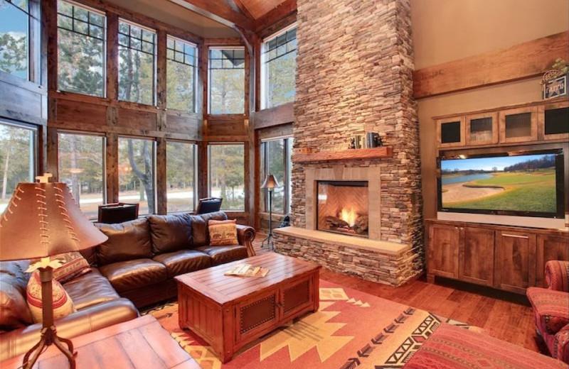 Vacation rental fireplace living room at Vacasa Rentals Sunriver.