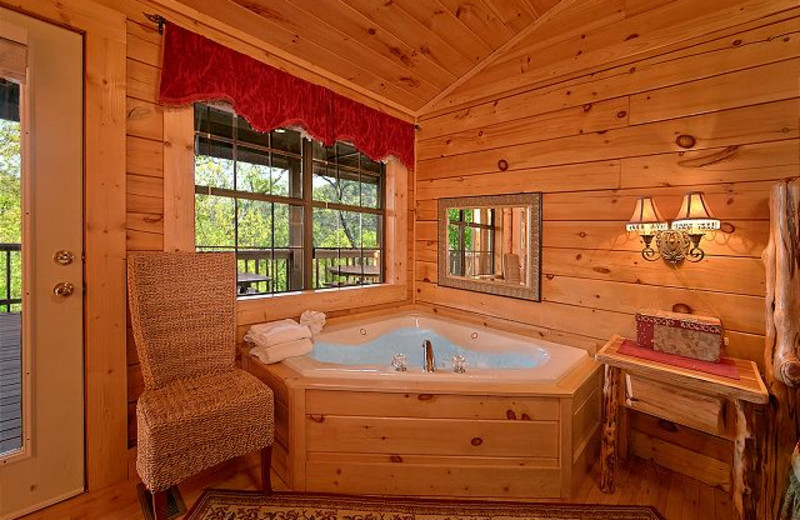 Cabin jacuzzi at Aunt Bug's Cabin Rentals, LLC.