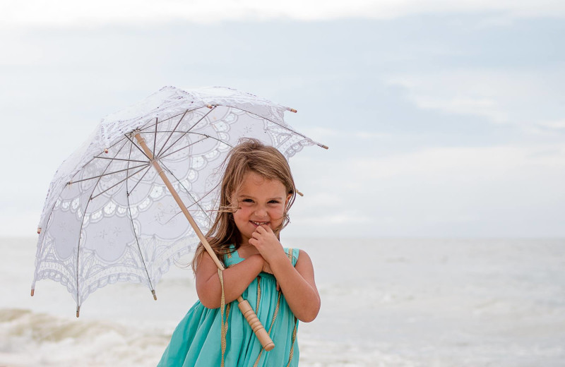 Child on beach at Sunset Properties.