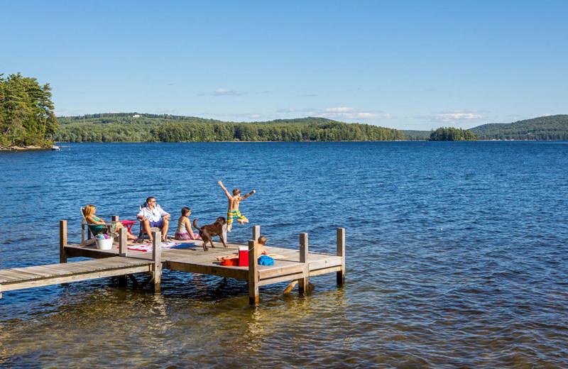Family on dock at At The Lake Vacation Rentals.