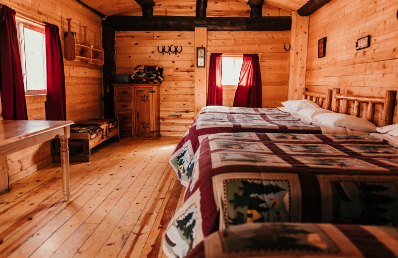 Cabin beds at Trappers Lake Lodge & Resort.
