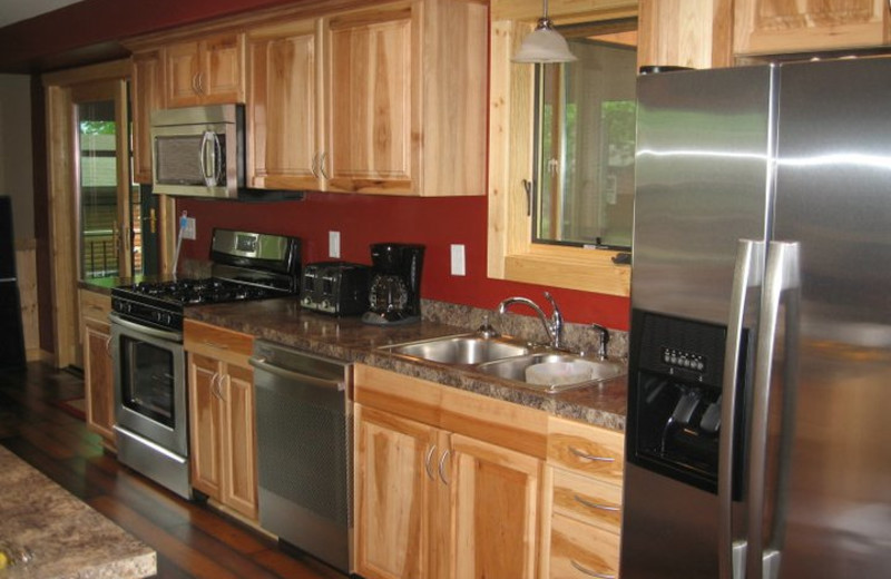 Cabin kitchen at Finn'n Feather Resort.