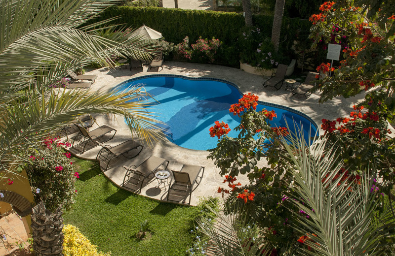 Outdoor pool at Encanto Inn Hotel & Suites.