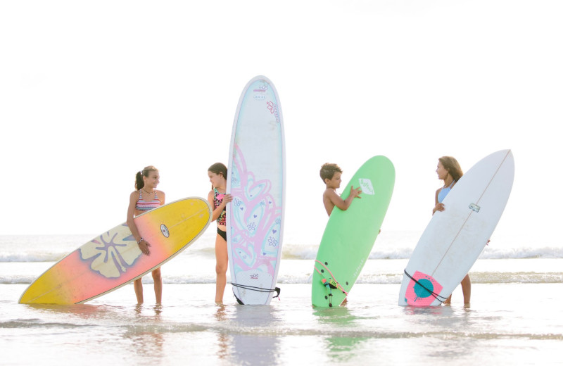 Surfing at Bald Head Island Limited.