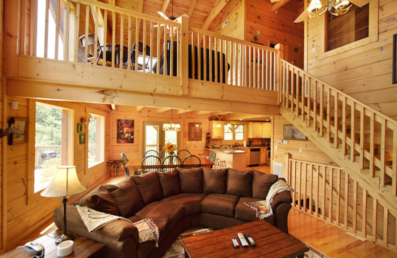 Rental living room and banister at Stony Brook Cabins, LLC.