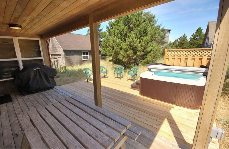 Rental hot tub at Shorepine Vacation Rentals.