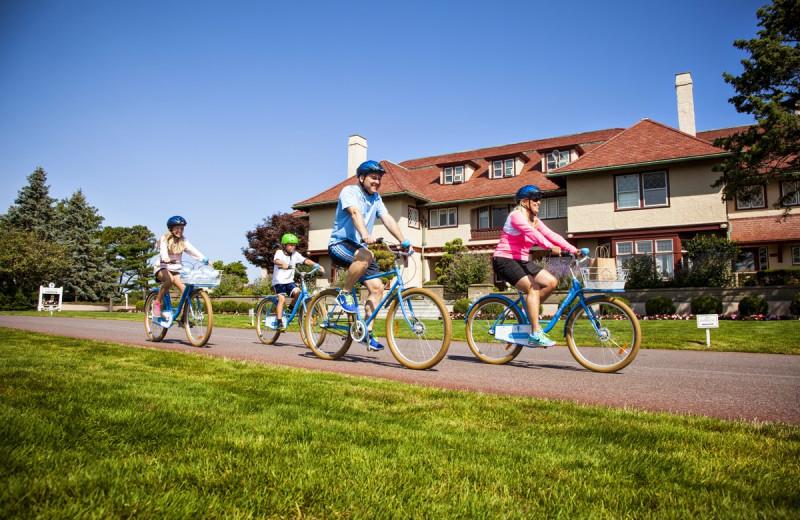 Family biking at Ocean Edge Resort & Golf Club.