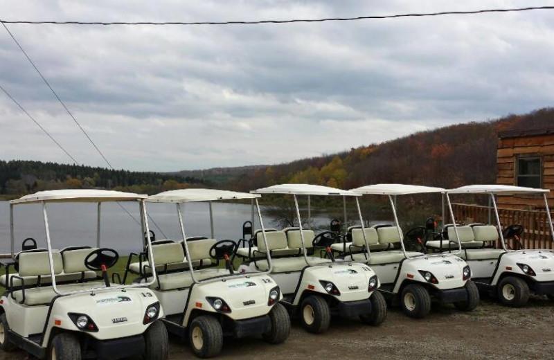 Golf carts at The Woods At Bear Creek Glamping Resort.