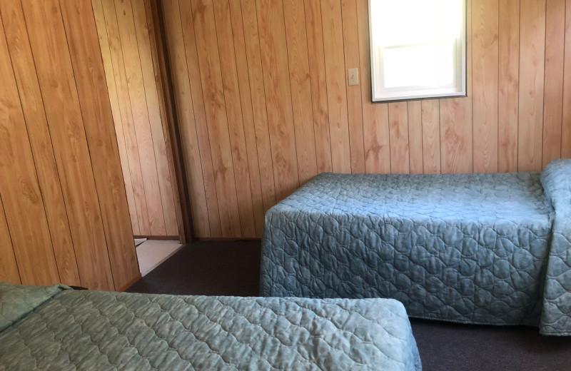 Cabin bedroom at Dogtooth Lake Resort.