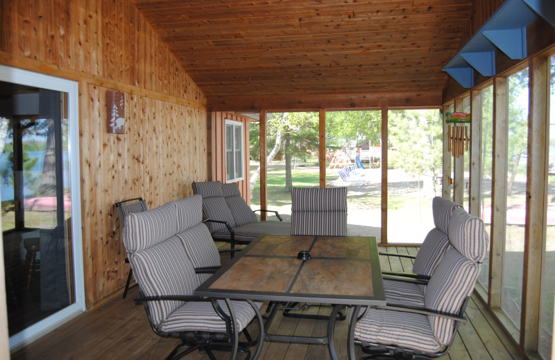 Cabin porch at Sandy Pines Resort.