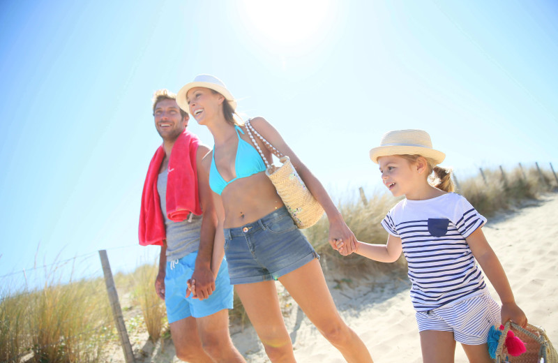 Family walking on beach at Resort Destinations.